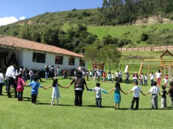 The volunteers and first kids gathering for prayer.