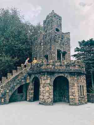 Couple climbing the fortress steps at Quinta de Regeleria