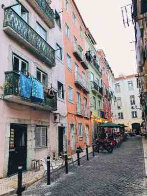Barrio Alto street with 5 different colors of buildings in Lisbon