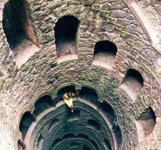 Aerial view of girl looking down the well in Quinta de Regeleria