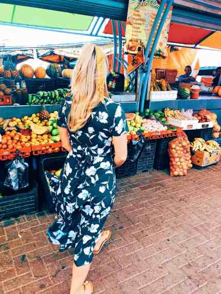 Fruits and vegetables stands at the floating market, one of the top things to do in Curacao