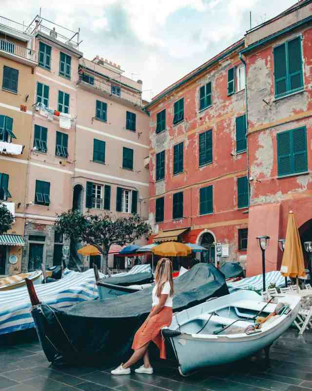 Sitting on boats in Vernazza harbour in Cinque Terre