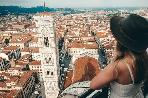 Girl in a hat overlooking Florence from the top of the Duomo