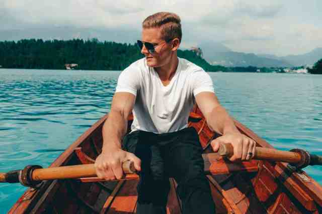 Rowing a boat, one of the top things to do in Lake Bled