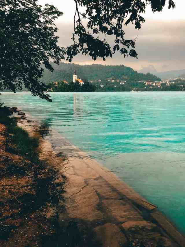 Shoreline of Lake Bled with beautiful turquoise water