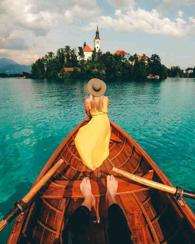 Row boat facing Bled Island on gorgeous Lake Bled, Slovenia