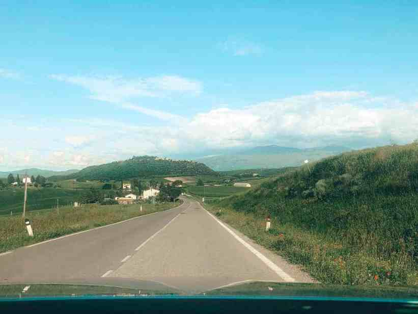 View from the windshield of the backroads of Italy during day trips from Florence