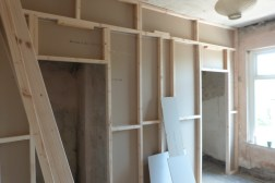 Wall creating a walk in wardrobe in the master bedroom
