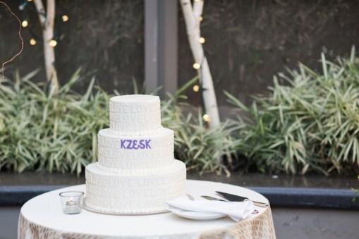 monogrammed-white-and-purple-wedding-cake