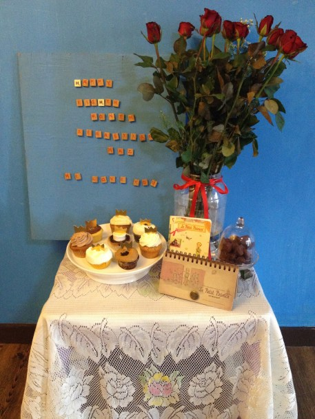 """the simple table set-up. I used red roses because of the """"flower"""" character from the book."""