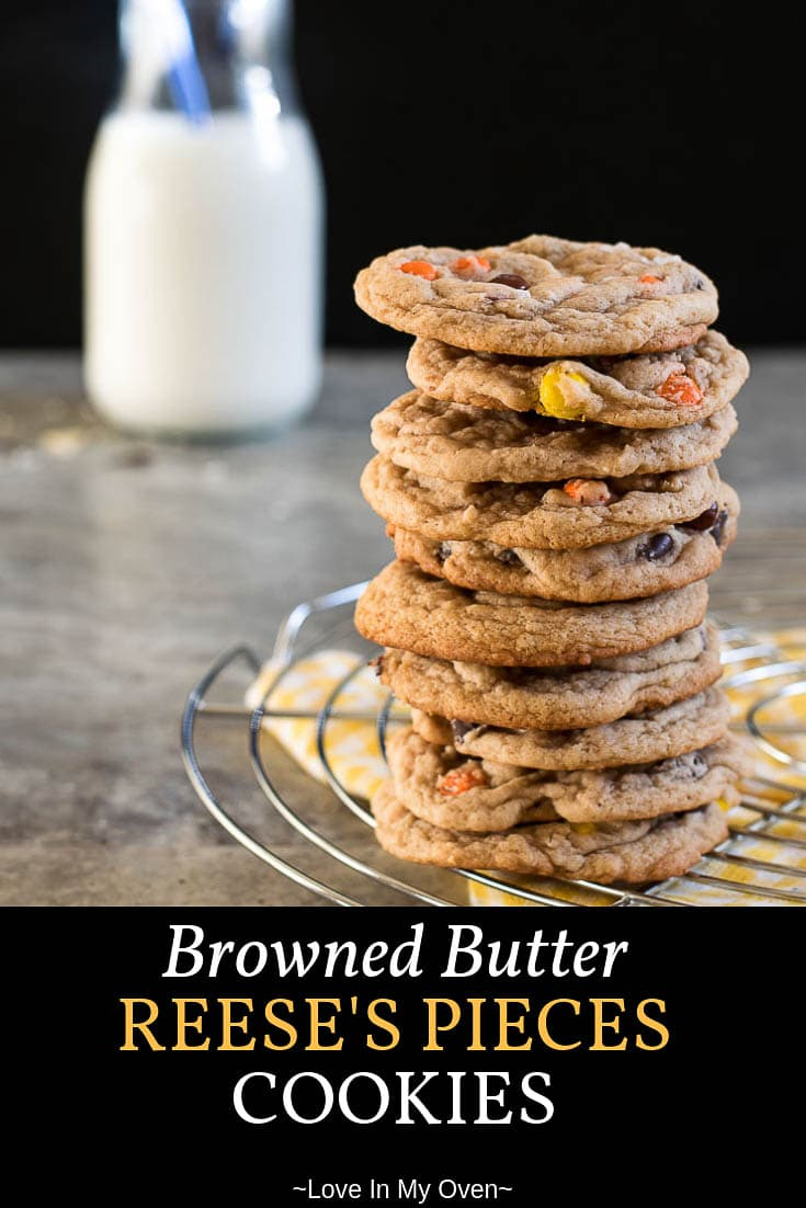 The softest, chewiest, cookies you\'ll ever make. Chocolate and peanut butter pairs perfectly in your new favourite chocolate chip cookie recipe! #brownedbutter #chocolatechip #reesespieces #reeses #cookies