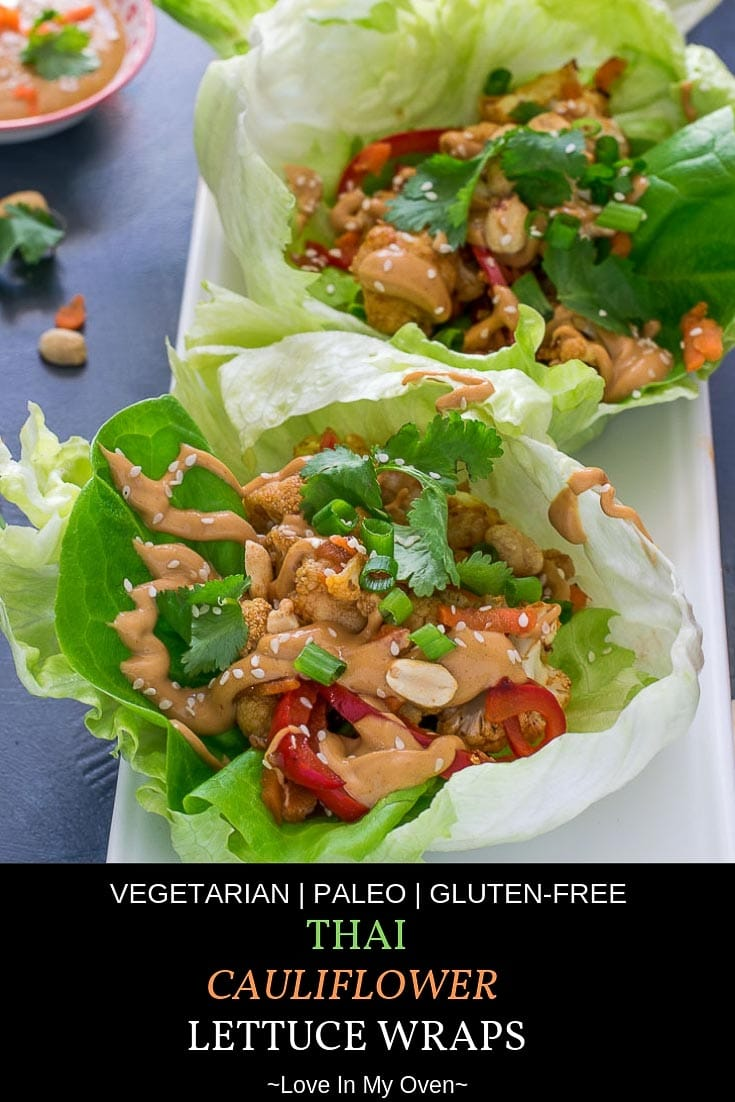 Crispy, crunchy cauliflower mixed with an assortment of veggies and coated in a mildy spicy Thai sauce, nestled into a bed of fresh, crisp lettuce leaves and drizzled with a sweet n' spicy peanut sauce! #thaifood #thairecipes #paleo #paleorecipes #meatless #cauliflowerrecipes #lettucewraps