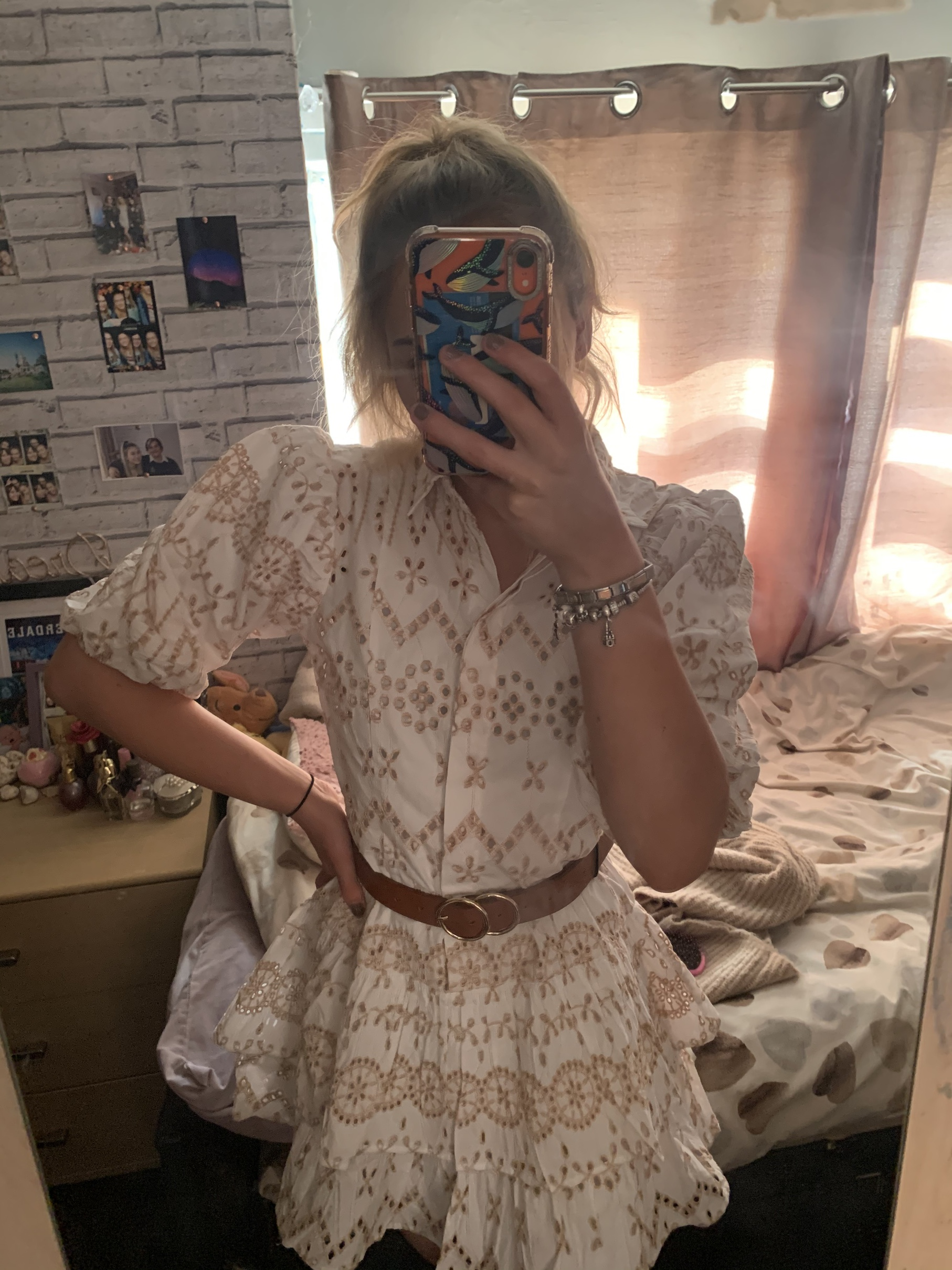 A white summer broderie dress that is a summer staple of mine