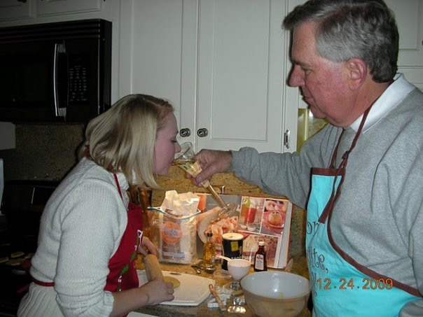 My dad and I making cookies in 2009 - with adult beverages.