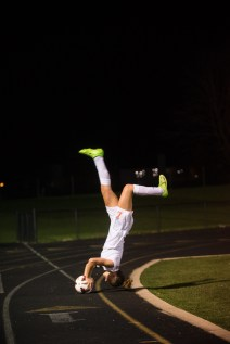 "Senior, Colleen ""Jelly"" Swift performs a front flip throwin"