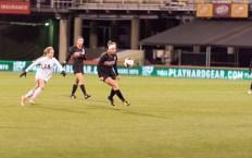 Junior, Brooke Harden, kicks the ball away from Perrysburg
