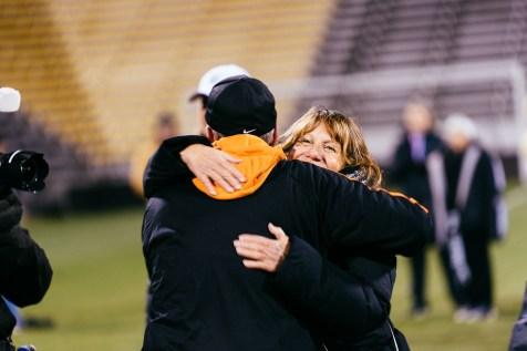 Principal Peggy Johnson hugs head coach Todd Kelly