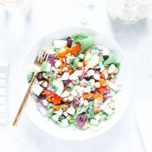 Chopped Greek salad in a bowl from above.