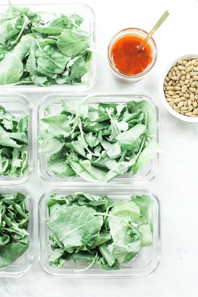 Meal prep containers with salad inside.