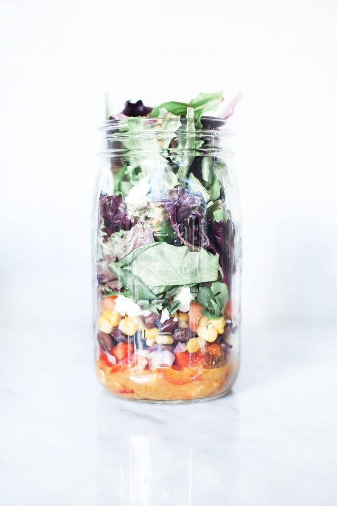 Layered salad in a mason jar.