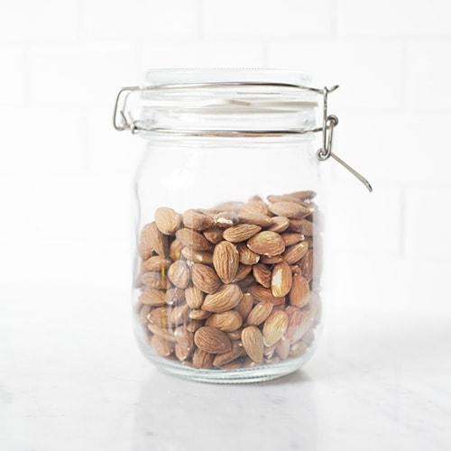 Almonds in a glass jar.