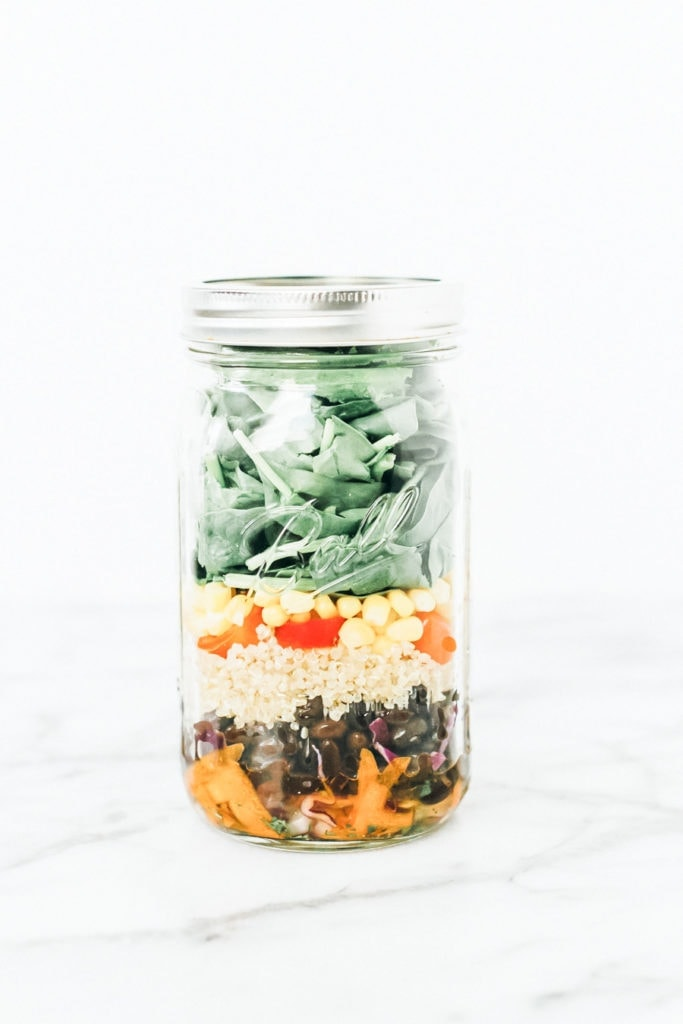 Black bean fiesta mason jar salad in a mason jar.