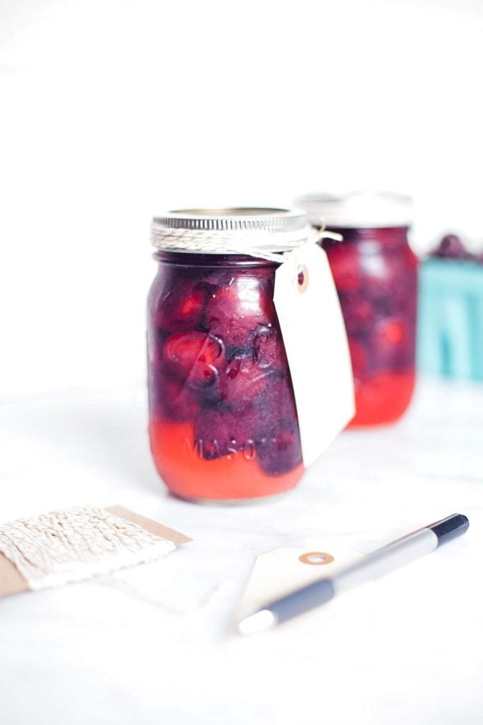 Pickled cherries in mason jars.