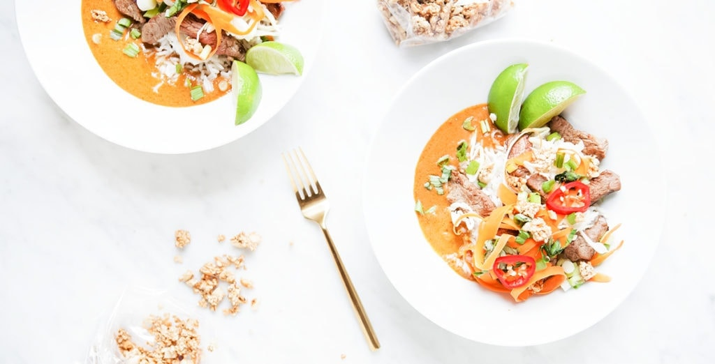 Curry Thai bowls in white bowls on white background.