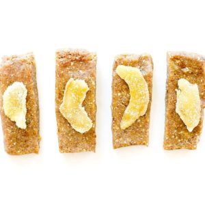 Gingerbread bars with crystallized ginger on a white background.