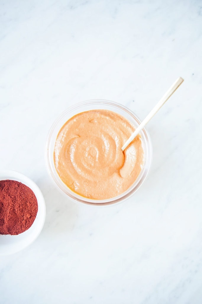 Gluten-free romesco sauce in a bowl with white background.