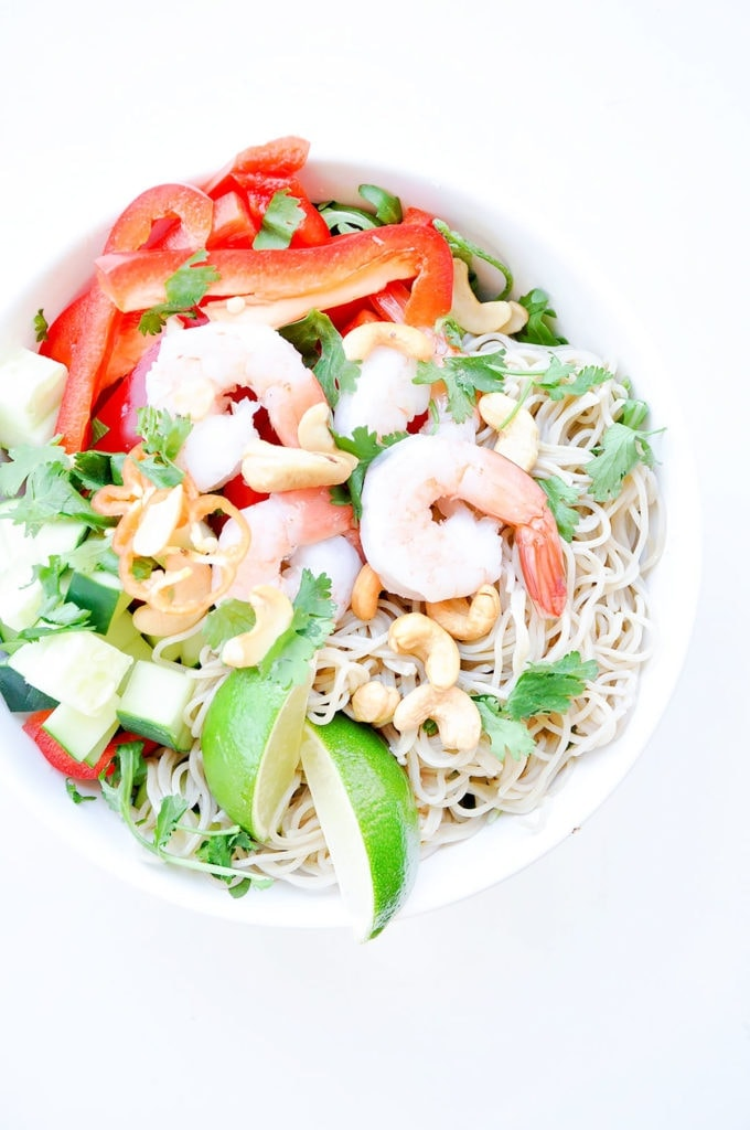 Shrimp noodle bowl in a white bowl on a white background.