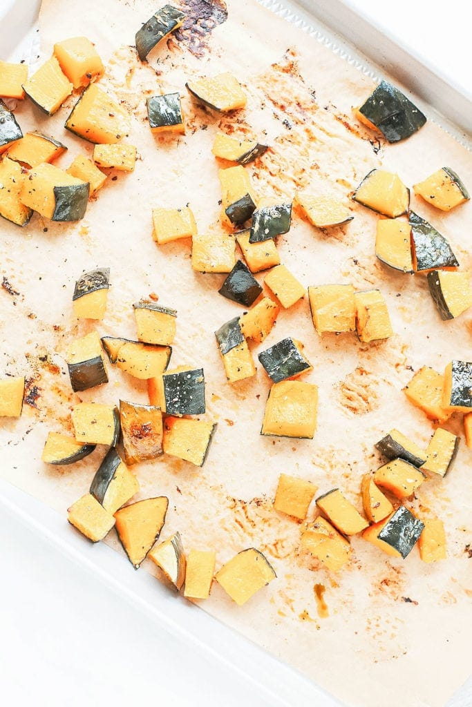 Kabocha squash cubes on a baking sheet.