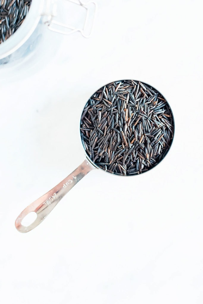 Wild rice in a measuring cup.