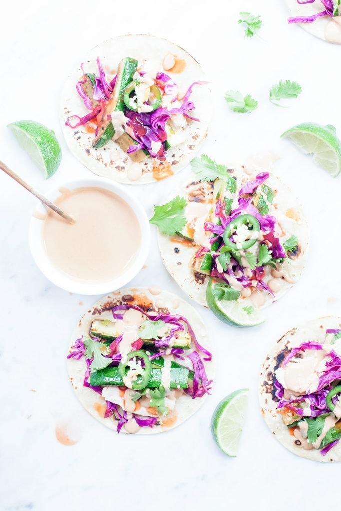 Zucchini and quinoa salad with chipotle tahini crema.