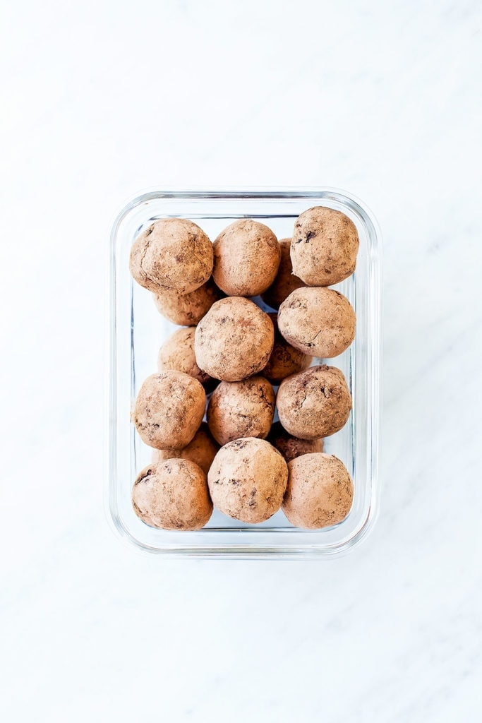 Chocolate collagen energy bites in a glass container.
