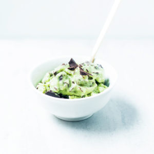Matcha mint chocolate chip nice cream in a white bowl.