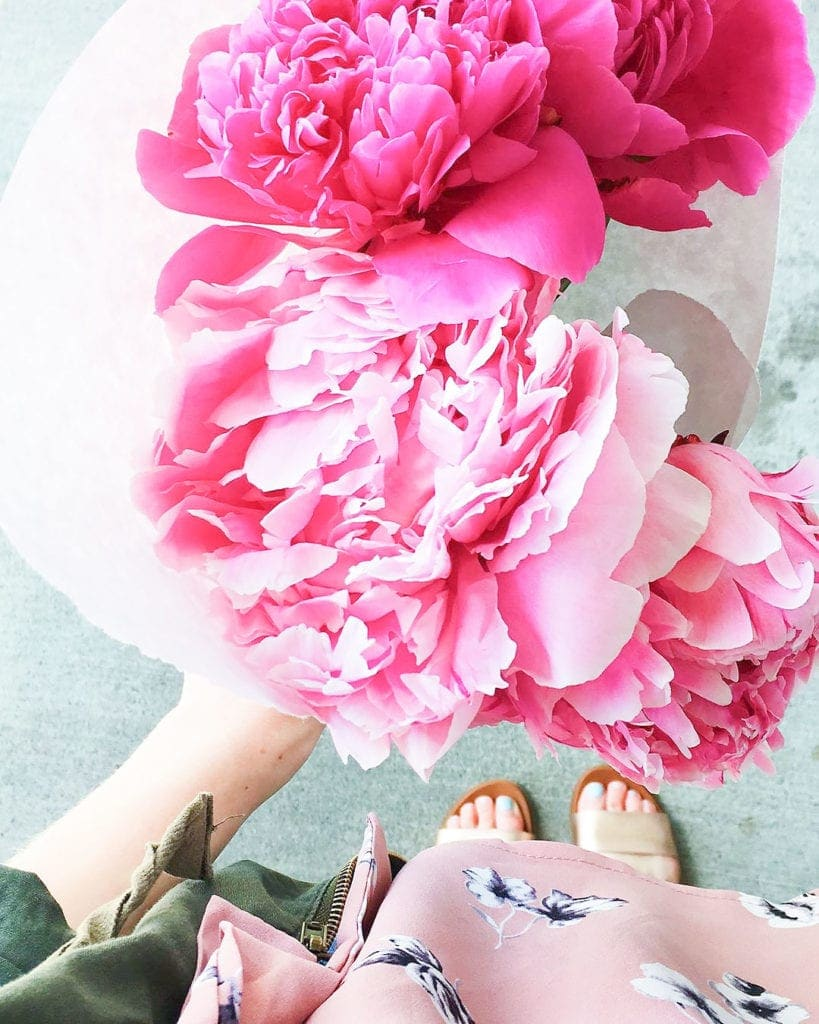 Pink flowers being held.