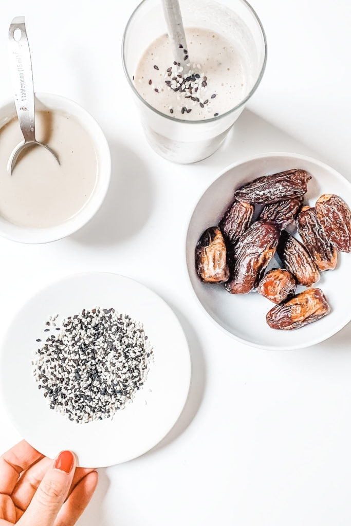 Tahini date shake ingredients on a white background.
