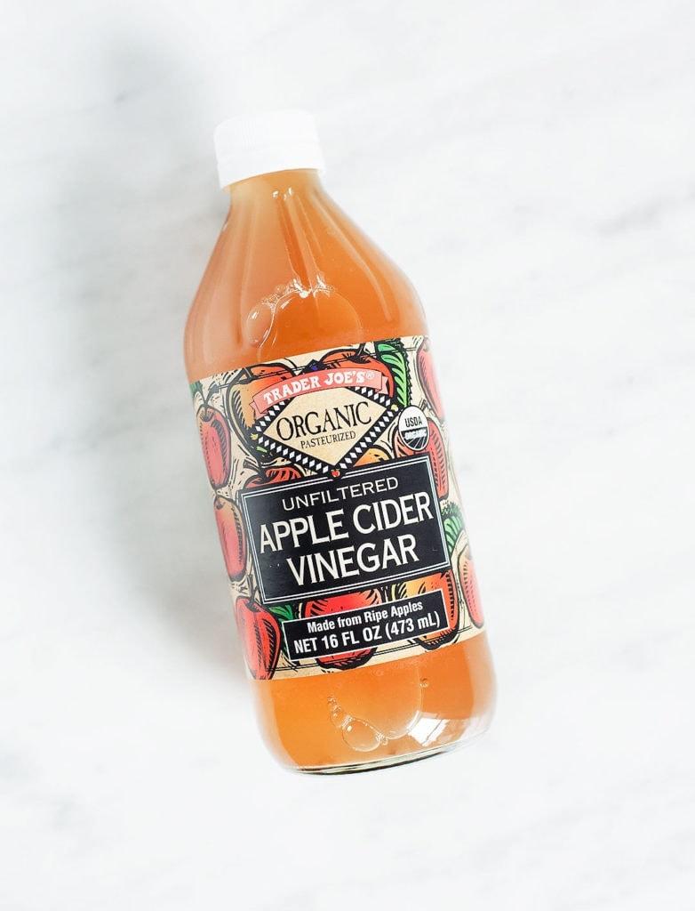 Trader Joe's apple cider vinegar on a white background.