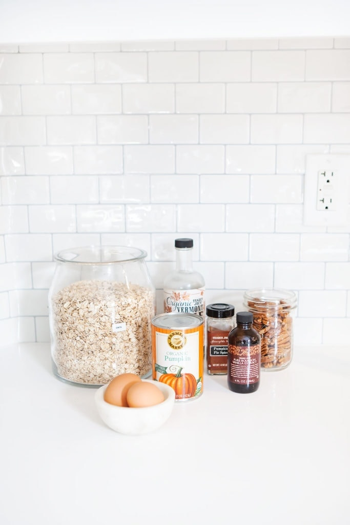 Pumpkin baked oatmeal ingredients on white countertop.