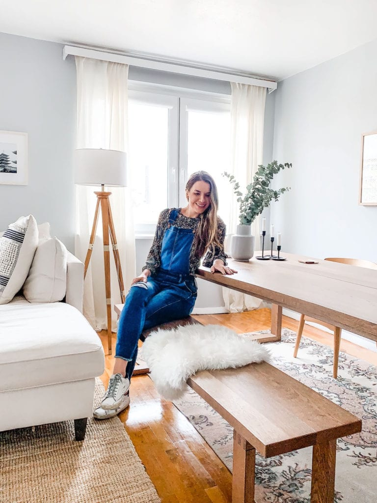 Ally, founder of Loveleaf Co., sitting in her dining room.