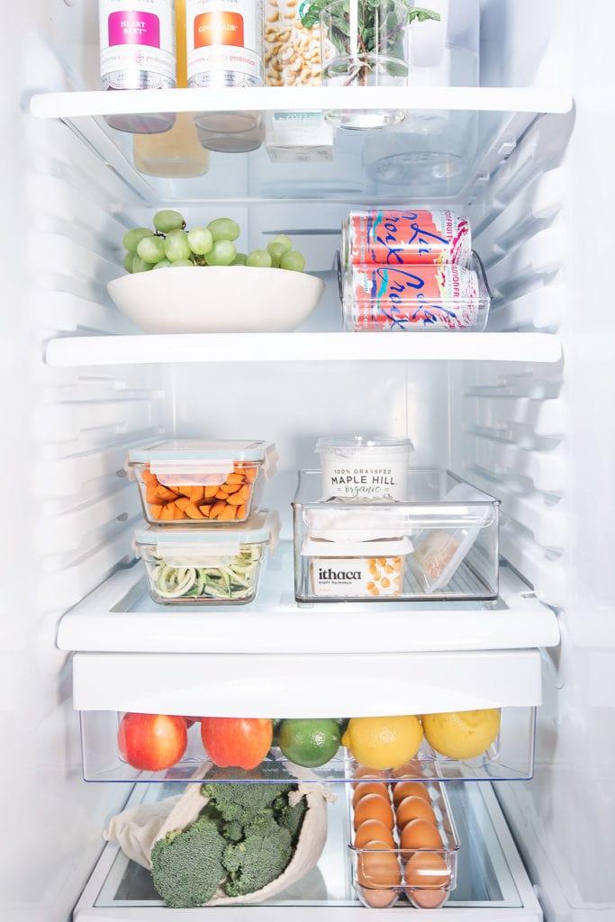 Clean fridge full of fresh foods.