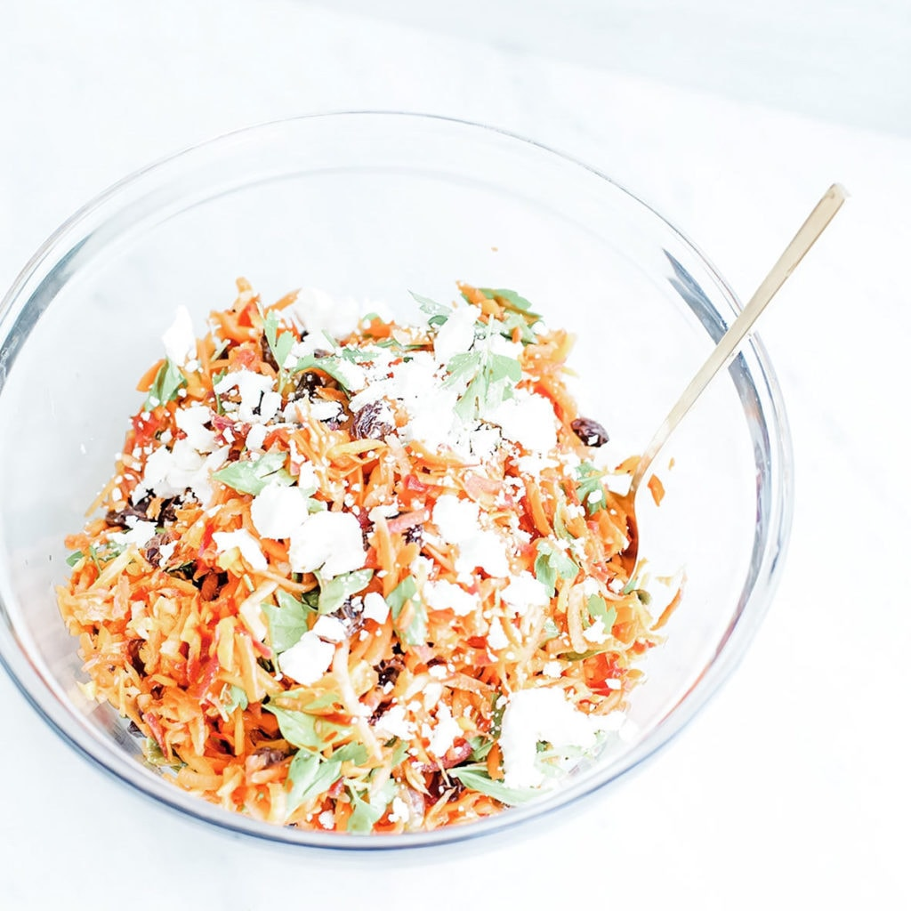 Harissa carrot salad in a glass bowl.