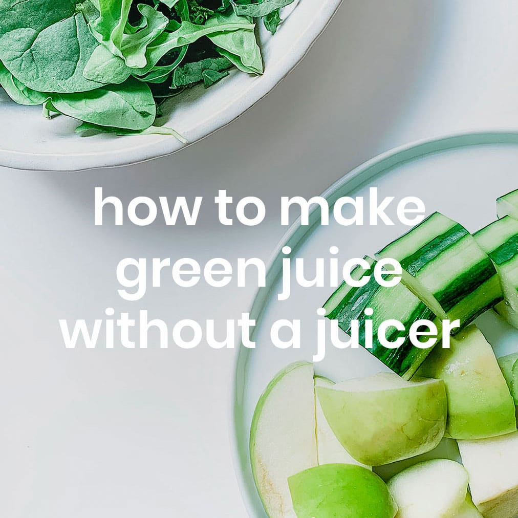 Green juice ingredients on a white table.
