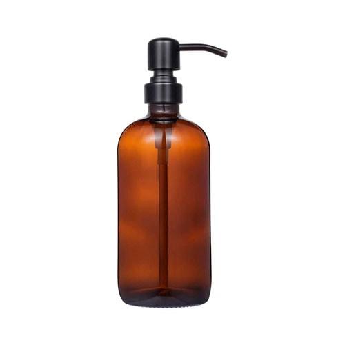 Amber glass soap dispenser.