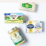 Butter, ghee, and vegan butter on a white background.