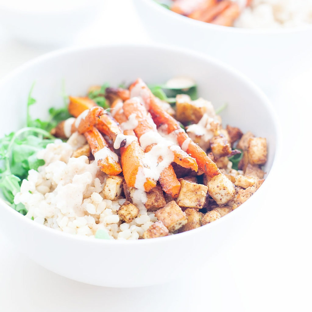 Fall harvest bowls with carrots and tofu from the side.