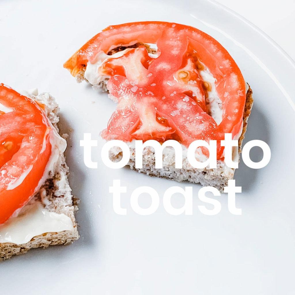 Tomato toast on a white plate.