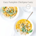 Easy pumpkin chickpea curry in two white bowls with lime slices.