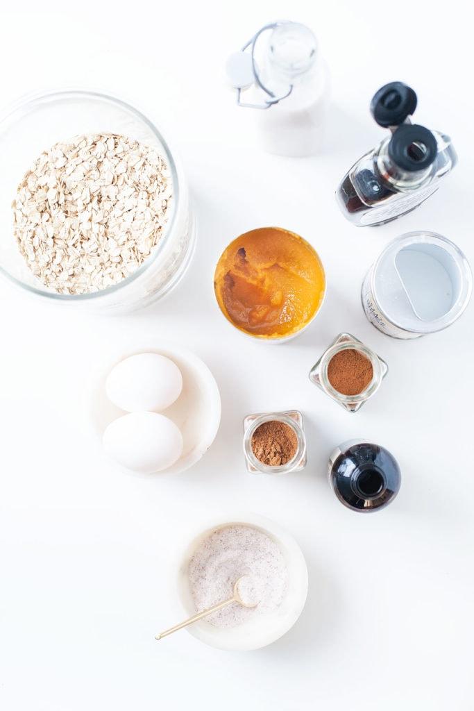 Gluten-free blender pumpkin pancake ingredients on a white countertop.